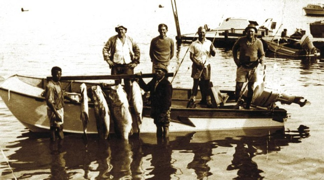 Back row left to right: Barny Barnard, Dr Chris Barnard, Hentie van Rooyen, Dr Andries van Zyl. Front: Andries ? and Mr. Grootboom with the day's catch